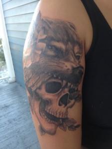 skull wearing wolf head